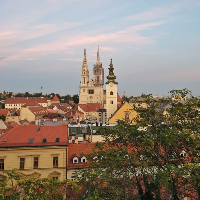 sunset over the old town of zagreb