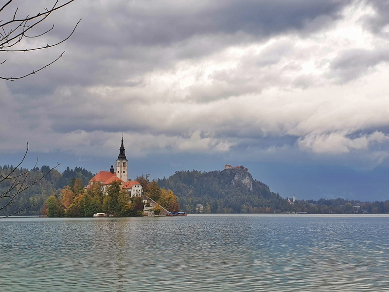 view of the island on lake bled with strong cloud formations