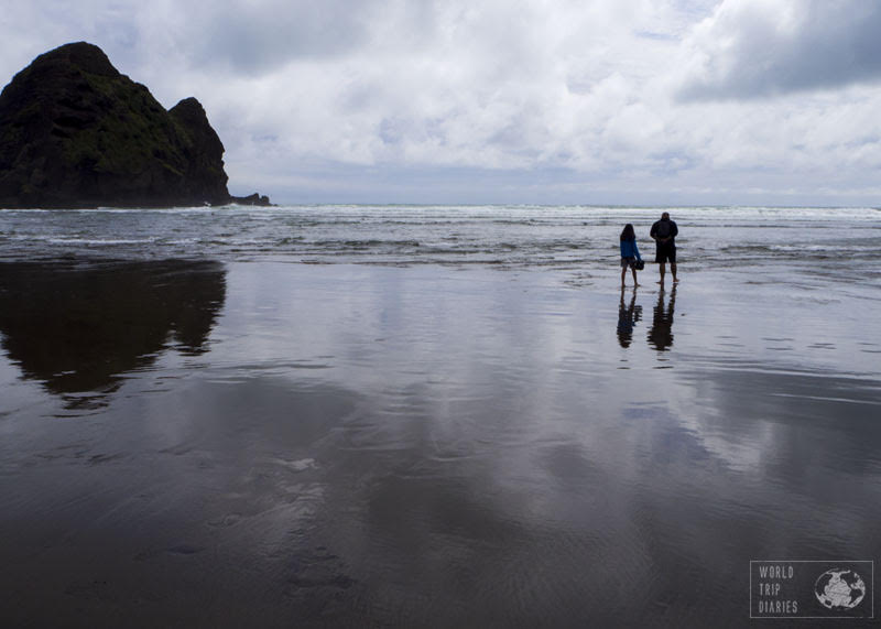 black sand beaches auckland